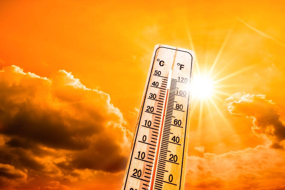 Photo of a heatwave showing a sun against a orange sky with a thermometer showing temperatures above 100 degrees F