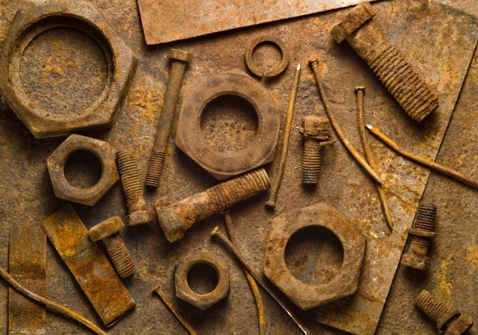 Photo of rusty tools on a rusty table backdrop