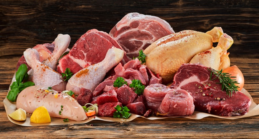 An assortment of raw meats, including: beef, chicken, and turkey